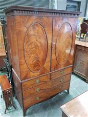 Sale 8939 - Lot 1038 - George III Mahogany Press on Chest, with arcaded top, two oval panel doors banded in rosewood, enclosing slides, with four drawrrs b...