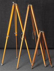 Sale 8984W - Lot 508 - Two matching timber tripods, each 135cm together with a smaller example.
