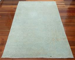 Sale 9134H - Lot 16 - A hand woven woollen Afghan Mahli Cadrys rug in blue and cream, 265cm x 181cm (staining)