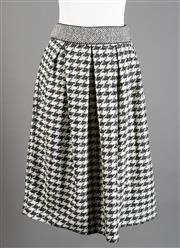 Sale 8499A - Lot 88 - A Proenza Schouler (New York) black and white herringbone pattern skirt, (86% wool, with silk lining). Size: 8.