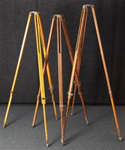 Sale 8984W - Lot 510 - Three very tall timber surveyors stands, near matching. Height  218cm