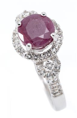 Sale 9169 - Lot 354 - A RUBY AND STONE SET RING; claw set in silver with a round cut ruby approx. 1.23ct to surround and shoulders set with round cut zirc...