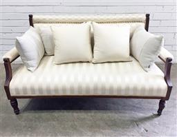 Sale 9126 - Lot 1077 - Late Victorian Inlaid Mahogany Settee, upholstered in a cream satin striped fabric, with matching scatter cushions, raised on turned...