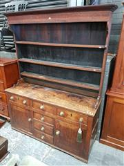 Sale 8814 - Lot 1028 - 19th Century Provincial Oak Dresser, the top with four shelves, the base fitted with six drawers & two panel doors, with brass handles