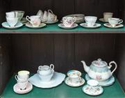 Sale 8908H - Lot 37 - A quantity of mix and match floral bone china including cups, saucers, trios, and plates in assorted patterns and colours