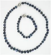 Sale 8477A - Lot 89 - SET OF DARK BLUE FRESHWATER PEARLS AND A MATCHING BRACELET: with magnetic clasp, necklace length 47cm; bracelet length 20.5cm.