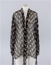 Sale 8760F - Lot 98 - A Dolce & Gabbana sheer black silk patterned tie-neck blouse printed with cherubs, size 42/12