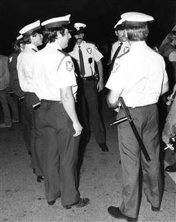 Sale 8912A - Lot 5051 - Security guards, Sydney Gay and Lesbian Mardi Gras Parade (1985), 20 x 25 cm, silver gelatin, Photographer: Tony Lewis