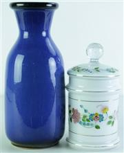 Sale 8968 - Lot 25 - A blue pottery vase (H30cm) together with a handpainted floral themed lidded jar (H21.5cm)