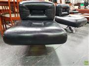 Sale 8585 - Lot 1046 - Pair of Oscar Niemeyer Lounge Chairs with Chrome Bases
