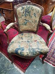 Sale 8728 - Lot 1076 - Pair of Louis XV Period Carved Walnut Armchairs, upholstered in antique tapestry fabric & raised on cabriole legs