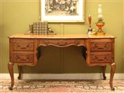Sale 8925H - Lot 1 - A large French Louis XV style carved oak five-drawer desk on cabriole legs, Height 73cm, Width 146cm, Depth 73cm