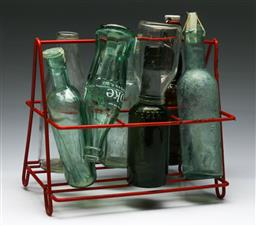 Sale 9153 - Lot 25 - A bottle rack containing vintage bottles (W: of rack 30cm)