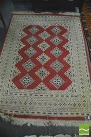 Sale 8352 - Lot 1051 - Red and Cream Tone Woollen Carpet (175 x 125cm)