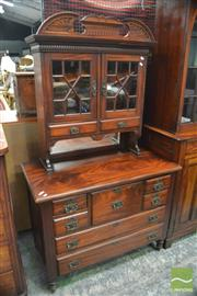 Sale 8390 - Lot 1003 - Edwardian Walnut Cabinet on Chest, with two astragal doors & two drawers, above seven variously sized drawers