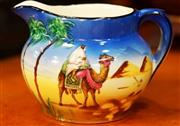 Sale 8320 - Lot 711 - A 1950s Beswick milk jug with desert and camel scenes