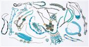 Sale 8640F - Lot 34 - An assortment of turquoise coloured necklaces to include a geometric metal example, tribal, pendant, wooden pieces and more.