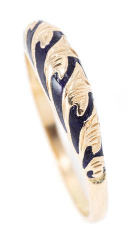 Sale 9169 - Lot 358 - A 14CT GOLD ENAMEL RING; half hoop inlaid with blue enamel featuring vine leaves, size Q, wt.2.70g.