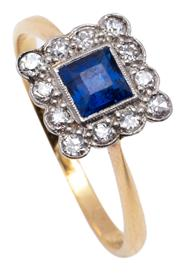 Sale 9015J - Lot 71 - An art deco 18ct gold, sapphire and diamond ring, the square cut sapphire framed by 12 diamonds