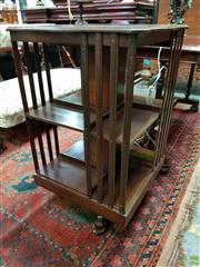 Sale 8576 - Lot 1016 - Edwardian Mahogany Revolving Bookcase, of two tiers, with serpentine edged top