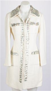 Sale 8640F - Lot 20 - A vintage Anna Sui cream coat embroidered with a shell trim to lapel and pockets, size medium.