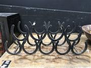 Sale 8851 - Lot 1008 - Horse Shoe Form Wine Rack