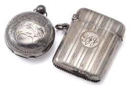 Sale 9124 - Lot 371 - ANTIQUE SILVER VESTA AND SOVEREIGN CASE; engraved sovereign case (missing catch, some dents), and guilloche vesta with engraved init...