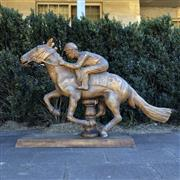 Sale 8795K - Lot 74 - A timber carved jockey on horse with stand
