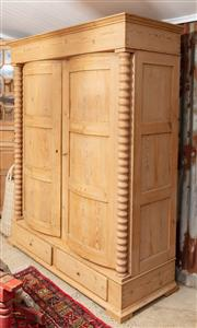 Sale 9060H - Lot 41 - A Baltic pine double door wardrobe with convex doors  flanked by turned pillars over a two drawer base, with two internal shelves. H...