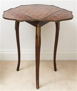 Sale 9140H - Lot 90 - A tri fold inlaid timber occassional table with gilt ormolu mounts over three sabre legs, Height 70cm, x Width 66cm