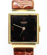 Sale 8402W - Lot 26 - UNIVERSAL 18CT GOLD RETRO WRISTWATCH; square black dial with red Roman numerals at the quarters on a 17 jewell cal. 259 manual movem...