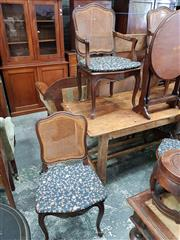Sale 8814 - Lot 1061 - Set of Eight Early 20th Century Louis XV Style Carved Oak Chairs, including two armchairs, with leather padded arms, all having cane...