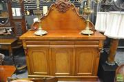 Sale 8345 - Lot 1031 - Late 19th Century Cedar Chiffonier or Sideboard, the carved back with perched bird, above three drawers & three doors enclosing a ce...