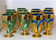 Sale 8703A - Lot 60 - A set of twelve footed goblets in blue green and gold with hobnail decoration