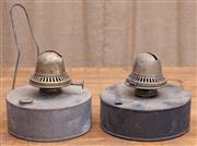 Sale 9026 - Lot 1080 - A near pair of early metal oil lanterns of cylindrical form, one with a handle, the brass burners by Veritas. Diameter 19cms.