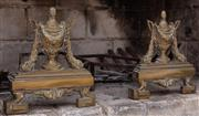 Sale 8908H - Lot 92 - A pair of brass urn form fire dogs, Length 40cm