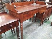 Sale 8917 - Lot 1080 - Regency Mahogany Desk, with gallery back, three drawers around a knee-hole & on turned legs (one back leg broken)