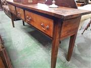 Sale 8814 - Lot 1052 - Antique Style French Possibly Cherrywood Console Table, with three drawers and on square legs. Width: 201 cm