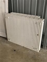 Sale 8677A - Lot 76 - A pair of vertical metal radiators, the larger H 85 x W 100cm