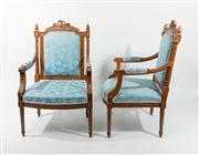 Sale 8716A - Lot 14 - A pair of French walnut Bergeres C: 1900. The carved backs and seats upholstered in blue and cream tapestry, the carved and shaped s...