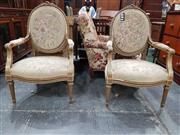 Sale 8774 - Lot 1003 - Pair of Louis XVI Style Gilt & Painted Gesso Armchairs, upholstered in floral tapestry (distressed) & raised on turned fluted legs