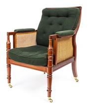 Sale 9015J - Lot 52 - A classic Paul Kenny Regency design vintage Library chair C: Late 1900s. The reeded back, arms and seat with hand caned inserts, th...