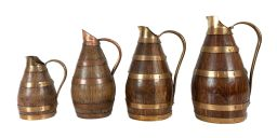 Sale 9150J - Lot 53 - A graduated set of 4 antique French oak with brass / copper banded cider jugs (factory stamped) - 16- 25 cm