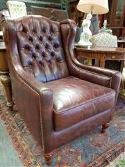 Sale 8576 - Lot 1078 - Moran Brown Buttoned Leather Wingback Armchair, with stud detailing & turned feet, ex David Jones