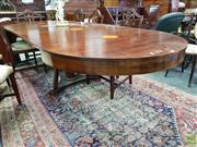 Sale 8576 - Lot 1054 - Neoclassical Style Fruitwood & Inlaid Extension Dining Table, the round top & three leaves with bat-wing inlay, on a faceted pedesta...