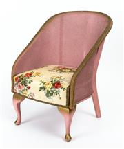 Sale 9015J - Lot 53 - A classic 1940s Lloyd Loom childs chair painted pink with gilt embellishments. The seat upholstered in red and yellow rose pattern ...