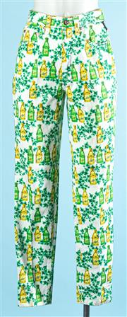 Sale 9090F - Lot 45 - A PAIR OF VERSACE STRAIGHT LEG JEANS; printed with champagne bottles and vine leaves , Size 26 waist