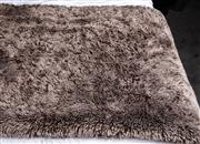 Sale 8761A - Lot 64 - A faux fur taupe coloured bed throw approx 180cm x 160cm