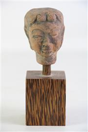 Sale 8926A - Lot 649 - Potted Buddha Head on wooden stand (H17cm)