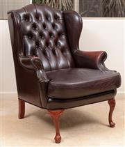 Sale 8926K - Lot 45 - A Moran burgundy buttoned leather wingback armchair